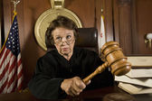 Judge Knocking A Gavel — Stock Photo