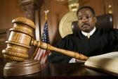 Gavel Lying In Front Of Judge — Stock Photo