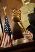 Judge Striking Gavel In Courtroom — Stock Photo