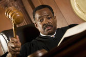 Judge Knocking Gavel In Courtroom — Stock Photo