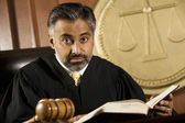 Judge Reading Law Book In Courtroom — Stock Photo