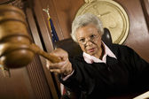 Judge Pointing Gavel In Courtroom — Stock Photo