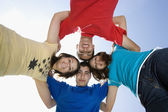 Friends Forming A Huddle Against Sky — Stock Photo
