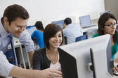 Teacher Helping Student In Computer Lab — Stock Photo