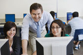 Teacher and Students in Computer Lab — Foto Stock