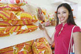 Beautiful Woman Shopping For Pillows — Stockfoto