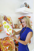 Blonde Woman Shopping For Pillows — Stock Photo