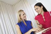 Saleswoman Handing Receipt to Customer — Stock Photo