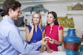 Salesman Handing Receipt With Credit Card To Shoppers — Stock Photo