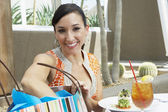 Woman With Shopping Bag Having Refreshments — Stock Photo