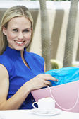 Beautiful Blonde Woman With Shopping Bag At Cafe — Stock Photo