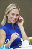 Blonde Woman Using Cell Phone — Stock Photo