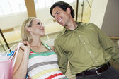 Cheerful Couple Looking At Each Other In Shopping Mall — Stock Photo
