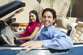 Couple Sitting In A Convertible — Stock Photo