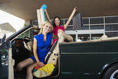 Shopaholic Female Friends In Convertible — Stock Photo