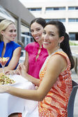 Female Friends Eating Out Together — Stock Photo