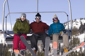 Happy Skiers On Chairlift — Stock Photo