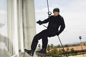 SWAT Team Officer Rappelling And Aiming Gun — Stock Photo