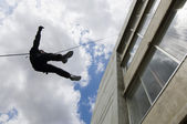 SWAT Team Officer Rappelling from Building — Stock Photo