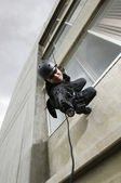 SWAT Team Officer Aiming Gun While Rappelling — Stock Photo