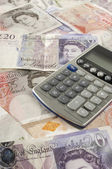 British Paper Currency And Calculator — Stock Photo