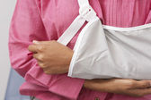 Woman's Arm In Sling — Stock Photo