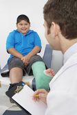 Doctor Interviewing Boy Patient — ストック写真