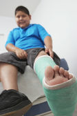 Boy With Leg In Plaster Cast — Stock Photo