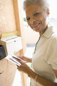 Senior Woman Collecting Letter From Mailbox — Stock Photo