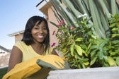 Woman Tending Plants — Stock Photo
