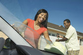 Happy Couple Washing Car — Stock Photo