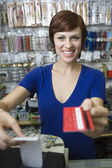 Female Sales Assistant At Cash Counter — Stock Photo