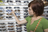 Woman Shopping For Sunglasses — Stok fotoğraf
