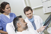 Dentist Explaining X-ray Reports To Patient — Stock Photo