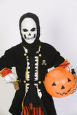 Boy In Grim Reaper's Outfit With Pumpkin Bucket — Stockfoto