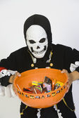 Boy In Halloween Outfit Holding Bowl Of Candies — Stock Photo