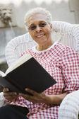 Senior Woman Holding Book — Stock Photo