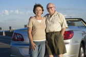Senior Couple Standing Against Car — Stock Photo