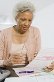 Senior Woman Reading Home Finances — Stock Photo