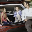 Children with their father sitting in the car — Stock Photo #21871477