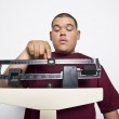 Young Man Using Weight Scales — Stock Photo