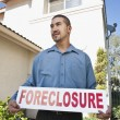 MHolding. Foreclosure Sign — Stock Photo #21870583