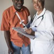 Stock Photo: Female Doctor Standing With Disabled Patient