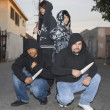 Four Aggressive Robbers Holding Knives — Stockfoto