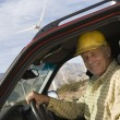 Senior Man In Truck At Wind Farm — Stockfoto