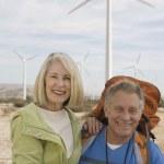 Senior Couple With Backpack Near Wind Farm — Stock Photo #21870817