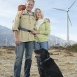 Senior Couple With Dog Near Wind Farm — Stock Photo