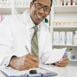 Male Pharmacist Working In Pharmacy — Stock Photo