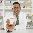 Male Pharmacist Working In Pharmacy — Stock Photo #21871115