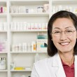 Portrait Of Female Pharmacist Smiling — Stock Photo #21871191